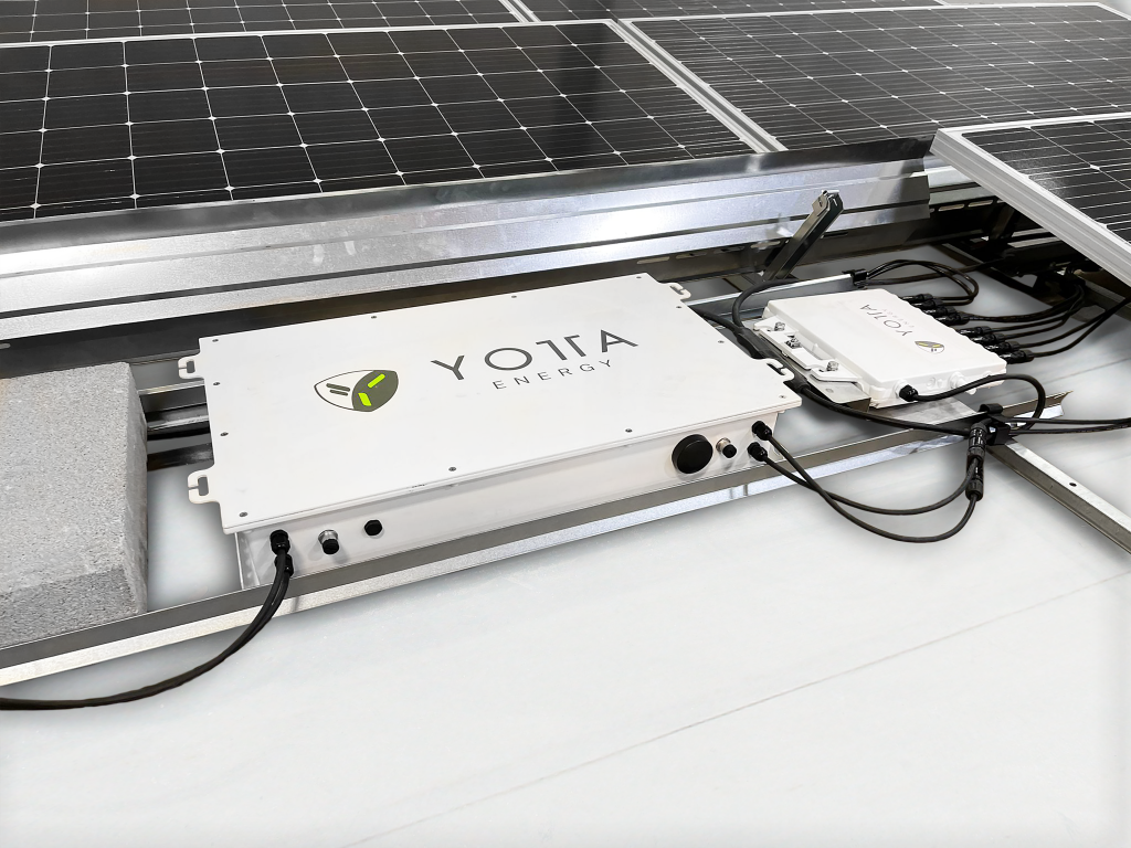 Deploying 1 kWh batteries under solar panels to reduce the cost of solar and storage at commercial properties. (Image: Yotta Energy)